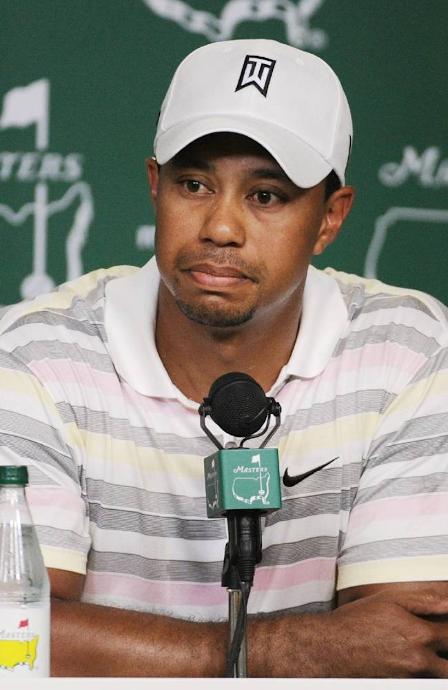 In this April 5, 2010 file photo, Tiger Woods listens to a question during his news conference at the Masters golf tournament in Augusta, Ga. Woods will miss the Masters for the first time in his career after having surgery on his back. Woods said on his website that he had surgery Monday, March 31, 2014, in Utah for a pinched nerve that had been hurting him for several months