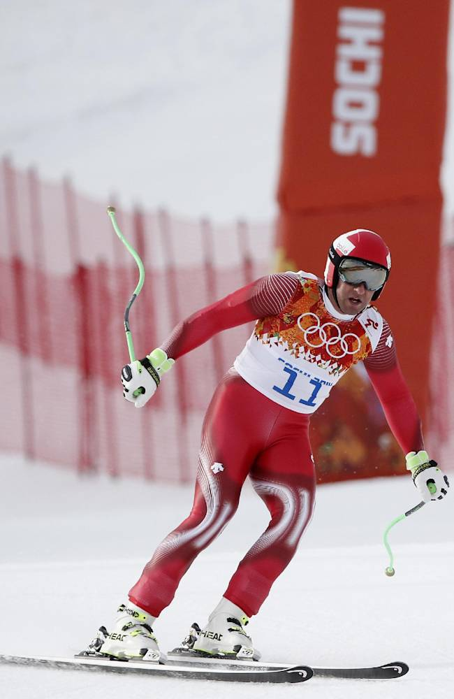 Switzerland's Silvan Zurbriggen comes to a halt in the finish area after completing Men's super combined downhill training at the Sochi 2014 Winter Olympics, Tuesday, Feb. 11, 2014, in Krasnaya Polyana, Russia