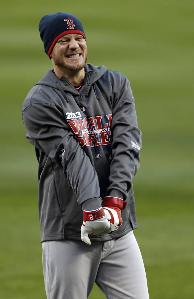 Boston Red Sox pitcher Jake Peavy stretches during baseball practice on Friday, Oct. 25, 2013, in St. Louis. Peavy is slated to start when the Red Sox play the St. Louis Cardinals in Game 3 of the World Series scheduled for Saturday in St. Louis