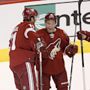 Arizona Coyotes' Martin Hanzal, left, celebrates his goal scored against the Los Angeles Kings with teammate Max Domi during the second period of a preseason NHL hockey game Monday, Sept. 22, 2014, in Glendale, Ariz The Associated Press