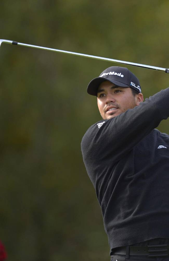 Jason Day, of Australia, tees off on the first hole as the tournament trophy is displayed behind him during the final round of the Northwestern Mutual World Challenge golf tournament at Sherwood Country Club, Sunday, Dec. 8, 2013, in Thousand Oaks, Calif