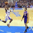 Los Angeles Clippers guard Chris Paul, left, puts up a shot as Los Angeles Lakers forward Pau Gasol, of Spain, looks on durin