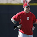 FILE - In this Feb. 20, 2014, file photo,Los Angeles Angels left fielder Josh Hamilton, left, talks to manager Mike Scioscia during spring training baseball practice in Tempe, Ariz. Reports that troubled Los Angeles Angels outfielder Josh Hamilton might be traded to the Texas Rangers dominated the chatter before the game between the teams Friday night April 24, 2015. (AP Photo/Rick Scuteri, File)