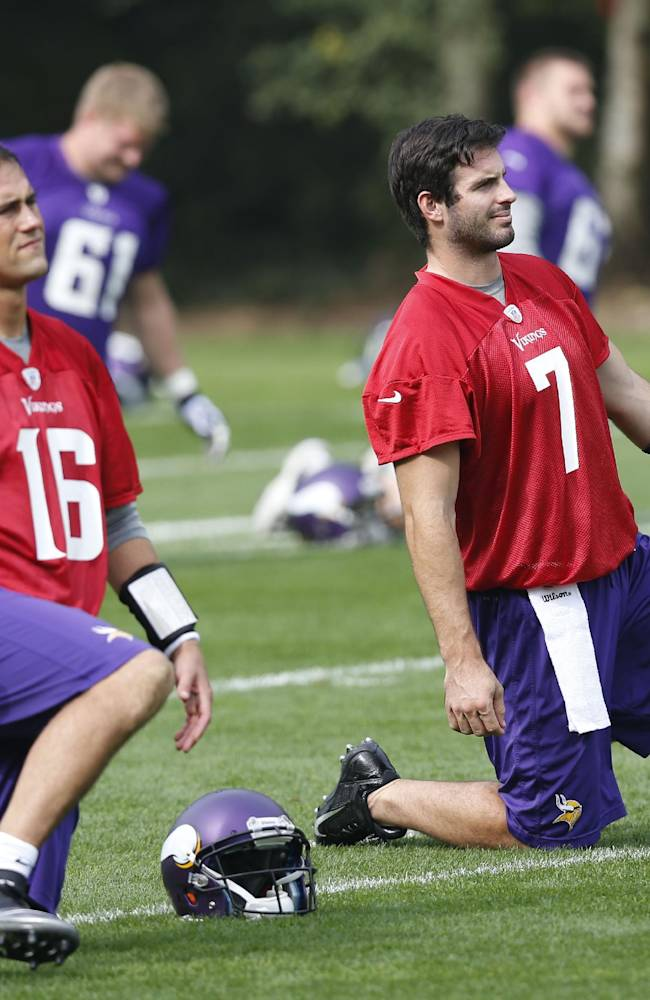 Minnesota Vikings' quarterback Christian Ponder, right, and quarterback Matt Cassel, left, warm up during their football practice at the Grove Hotel in Watford, England,  Wednesday, Sept. 25, 2013. The Vikings play Pittsburgh Steelers on Sunday in a NFL football game at Wembley Stadium  in London