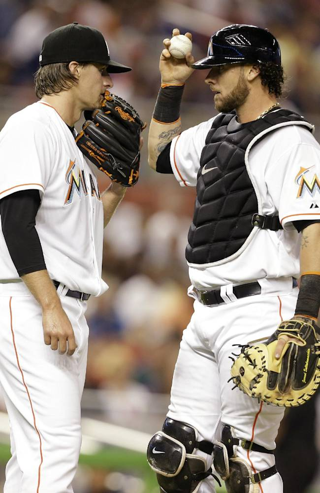 Miami Marlins starting pitcher Tom Koehler, left, talks with catcher Jarrod Saltalamacchia during the first inning of the MLB National League baseball game against the Washington Nationals, Tuesday, April 15, 2014, in Miami