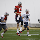 New England Patriots quarterback Tom Brady (12) warms up with wide receiver Julian Edelman, left, and tight end Rob Gronkowski (87) during practice Thursday, Jan. 29, 2015, in Tempe, Ariz. The Patriots play the Seattle Seahawks in NFL football Super Bowl