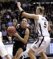 South Carolina guard La'Keisha Sutton, left, drives on Purdue's Brittany Rayburn during the first half of NCAA tournament second-round women's college basketball game in West Lafayette, Ind., Monday, March 19, 2012. (AP Photo/Michael Conroy)