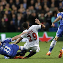 Chelsea's Frank Lampard, left fouls Paris Saint-Germain's Lucas during the Champions League quarterfinal second leg soccer match between Chelsea and Paris Saint Germain at Stamford Bridge stadium in London, Tuesday, April 8, 2014