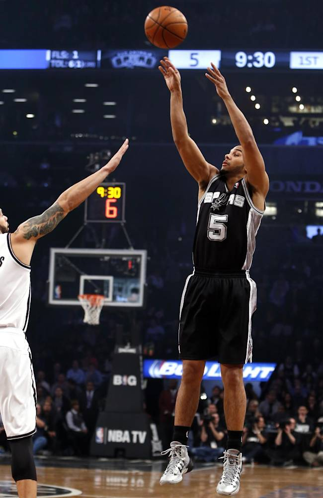 San Antonio Spurs' Cory Joseph (5) shoots against Brooklyn Nets' Deron Williams during the first half of an NBA basketball game on Thursday, Feb. 6, 2014, in New York