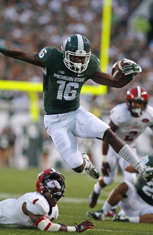 Cook terrific, Spartans beat Jacksonville St 45-7