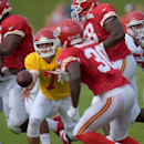 Kansas City Chiefs quarterback Aaron Murray (7) pitches the ball to Joe McKnight (30) during practice Monday morning, Aug. 11, 2014, on the Missouri Western State University campus in St. Joseph. Mo The Associated Press