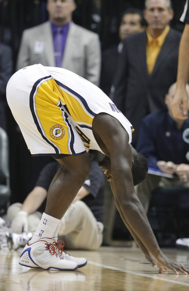 Indiana Pacers' Lance Stephenson bends over after getting injured during the first half of an NBA basketball game against the Toronto Raptors on Friday, Nov. 8, 2013, in Indianapolis