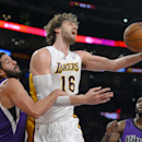Los Angeles Lakers center Pau Gasol, right, of Spain, puts up a shot as Sacramento Kings guard Greivis Vasquez, of Venezuela, defends during the first half of an NBA basketball game Sunday, Nov. 24, 2013, in Los Angeles The Associated Press