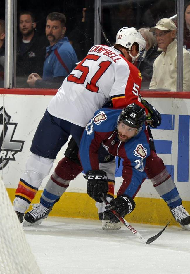 Florida Panthers defenseman Brian Campbell (51) pushes down Colorado Avalanche center Maxime Talbot (25) during the first period of an NHL hockey game on Saturday, Nov. 16, 2013, in Denver