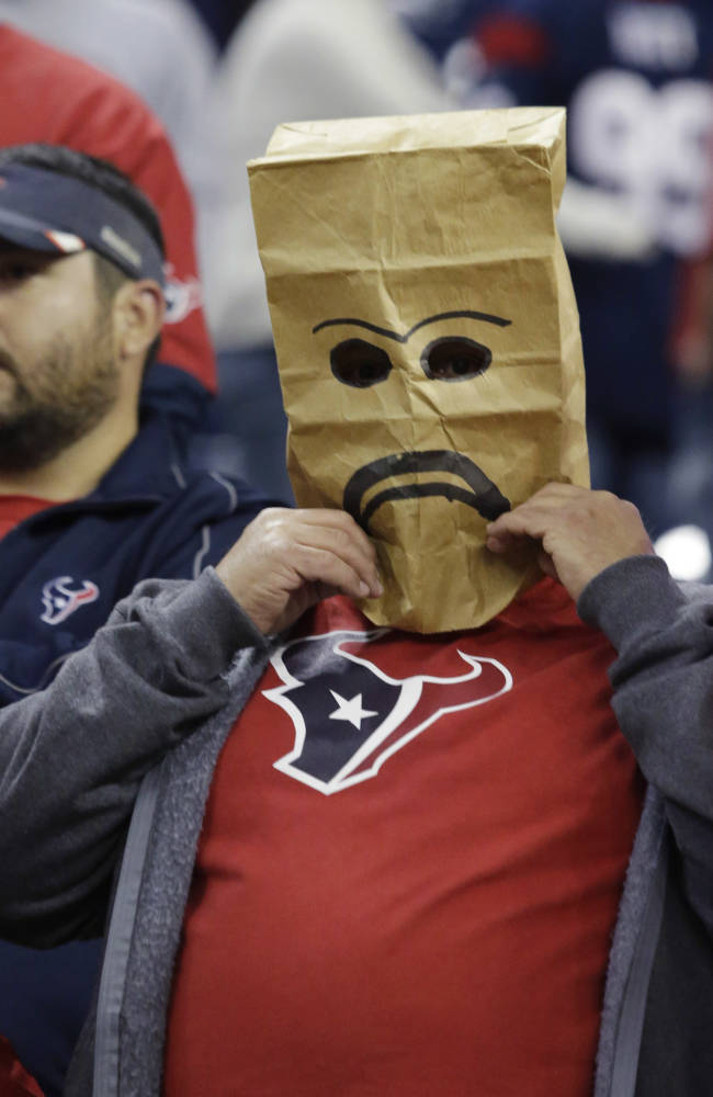 A fan wears a sack over his head after the Houston Texans lost to the Indianapolis Colts in an NFL football game, Sunday, Nov. 3, 2013, in Houston. Indianapolis won 27-24