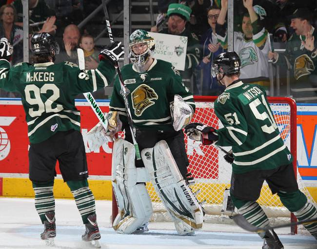 Michael Houser, Greg McKegg, and Austin Watson of the London Knights celebrate a victory in Game Three of the OHL Championship final