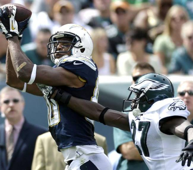 San Diego Chargers' Malcom Floyd, left, pulls in a pass as Philadelphia Eagles' Brandon Hughes defends during the first half of an NFL football game, Sunday, Sept. 15, 2013, in Philadelphia