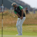 Victor Dubuisson of France chips onto the 7th green during the final round of the British Open Golf championship at the Royal Liverpool golf club, Hoylake, England, Sunday July 20, 2014