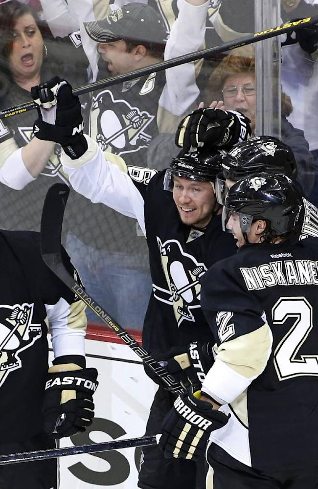 Pittsburgh Penguins' Jussi Jokinen, center, celebrates his goal with teammates in the third period of game 2 of a second-round NHL playoff hockey series against the New York Rangers in Pittsburgh Sunday, May 4, 2014. The Penguins won 3-0, to tie the series at 1-1