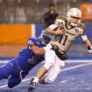Western Michigan quarterback Zach Terrell (11) is brought down by Air Force linebacker Jordan Pierce (51) during the first half of the Famous Idaho Potato Bowl NCAA college football game in Boise, Idaho, on Saturday, Dec. 20, 2014. (AP Photo/Otto Kitsinger)