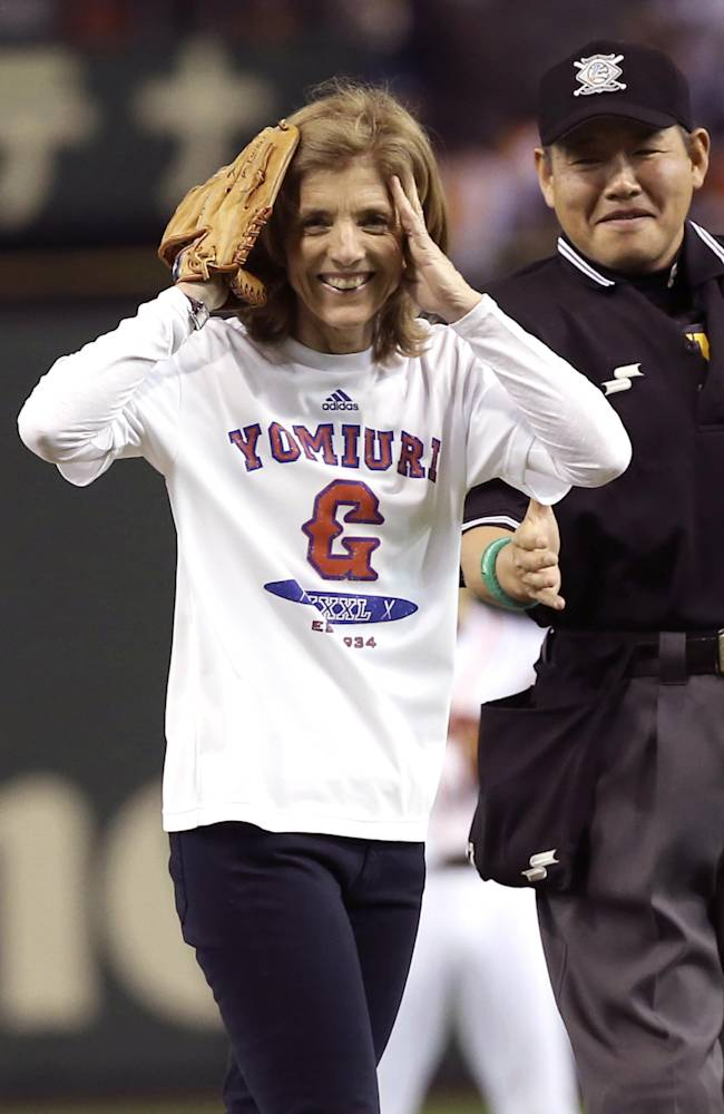 U.S. Ambassador to Japan Caroline Kennedy reacts after throwing out the ceremonial first pitch before the Japan's Central League professional baseball opening game between the Yomiuri Giants and the Hanshin Tigers at Tokyo Dome in Tokyo, Friday, March 28, 2014
