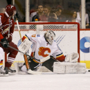 Calgary Flames goaltender Karri Ramo, of Finland, makes a pad save on the re-direction by Arizona Coyotes' Shane Doan, left, during the third period of an NHL game Saturday, Nov. 29, 2014 in Glendale, Ariz The Associated Press