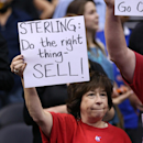 Los Angeles Clippers hold up signs referencing the Donald Sterling situation before the game with the Golden State Warriors in Game Five of the Western Conference Quarterfinals during the 2014 NBA Playoffs at Staples Center on April 29, 2014 in Los Angeles, California. (Photo by Stephen Dunn/Getty Images)