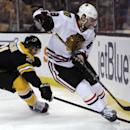 Boston Bruins left wing Loui Eriksson, left, tries to strip the puck away from Chicago Blackhawks defenseman Nick Leddy during the second period of an NHL hockey game, Thursday, March 27, 2014, in Boston The Associated Press