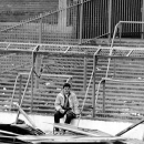 "FILE - In this April 15, 1989 file photo a lone soccer supporter sits by the damaged fencing at Hillsborough Stadium, in Sheffield, England. The 96 Liverpool soccer fans who died in the Hillsborough Stadium disaster were ""unlawfully killed"" because of err"