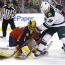 Minnesota Wild left wing Jason Zucker (16) attempts a shot on the goal as Florida Panthers goalie Roberto Luongo (1) defends during the first period of an NHL hockey game, Monday, Nov. 24, 2014, in Sunrise, Fla The Associated Press