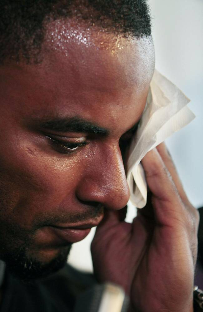 New Orleans Saints safety Darren Sharper wipes his face as he talks during a news conference to announce the Home Run For Kids charity softball game, which benefits charitable organizations such as the American Cancer Society and the Sharper Kids Foundation in Metairie, La., Wednesday, June 1, 2011