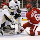 Pittsburgh Penguins goalie Thomas Greiss (1), of Germany, stops a Detroit Red Wings left wing Justin Abdelkader (8) shot in the second period of an NHL hockey game in Detroit, Thursday, Oct. 23, 2014. (AP Photo/Paul Sancya)