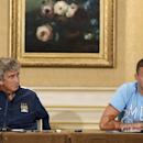 Manchester City Football Club manager Manuel Pellegrini, left, listens as striker Edin Dzeko speaks during a news conference in New York, Tuesday, July 29, 2014, in advance of Wednesday's Guinness International Champions Cup soccer match against rival Liv