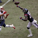 New England Patriots' Julian Edelman (11) reaches for a pass as Houston Texans' Kareem Jackson (25) defends during the third quarter of an NFL football game Sunday, Dec. 1, 2013, in Houston The Associated Press