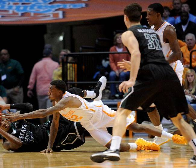 South Carolina-Upstate's Torrey Craig looks to pass the ball as Tennessee's Jordan McRae defends during the second half of an NCAA college basketball game in Knoxville, Tenn., Saturday, Nov. 16, 2013. Tennessee won 74-65