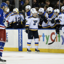 St. Louis Blues right wing Vladimir Tarasenko (91) celebrates his goal with teammates as New York Rangers left wing Rick Nash (61) skates away in the second period of an NHL hockey game at Madison Square Garden on Monday, Nov. 3, 2014, in New York The Ass