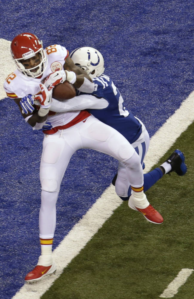 Kansas City Chiefs wide receiver Dwayne Bowe (82) scores a touchdown as Indianapolis Colts free safety Darius Butler (20) defends during the first half of an NFL wild-card playoff football game Saturday, Jan. 4, 2014, in Indianapolis