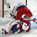 Washington Capitals right wing Troy Brouwer (20) runs into Montreal Canadiens goalie Carey Price (31) during the second period of an NHL hockey game Saturday, Jan. 31, 2015, in Montreal The Associated Press