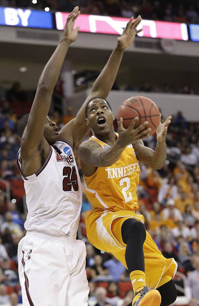 Tennessee guard Antonio Barton (2) shoots over Massachusetts' Cady Lalanne during the first half of an NCAA college basketball second-round tournament game, Friday, March 21, 2014, in Raleigh, N.C