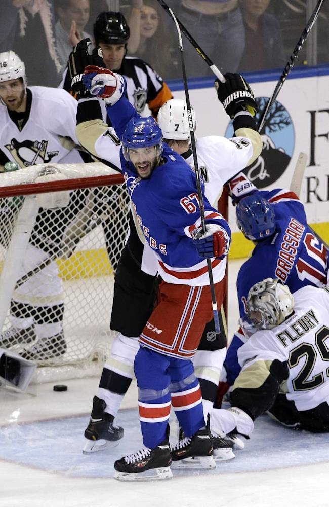 New York Rangers left wing Benoit Pouliot (67) celebrates a goal by teammate Derick Brassard (16) during the second period of Game 6 of a second-round NHL playoff hockey series against the Pittsburgh Penguins, Sunday, May 11, 2014, in New York