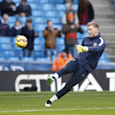 Manchester City's goalkeeper Joe Hart kicks a ball as he warms up prior to the English Premier League soccer match between Manchester City and Arsenal at the Etihad Stadium, Manchester, England, Sunday, Jan. 18, 2015