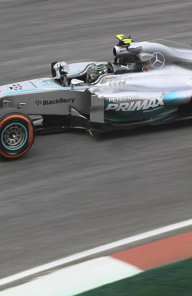 Mercedes driver Nico Rosberg of Germany steers his car during the second practice session for the Malaysian Formula One Grand Prix at Sepang International Circuit in Sepang, Malaysia, Friday, March 28, 2014
