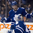 Toronto Maple Leafs Tyler Bozak and goaltender Jonathan Bernier celebrate after defeating the Calgary Flames in NHL hockey action in Toronto on Tuesday April 1, 2014 The Associated Press