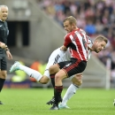 Sunderland's Lee Cattermole, left, and Swansea City's Gylfi Sigurdsson battle for the ball during the English Premier League match against Swansea at the Stadium of Light, Sunderland, England Saturday Sept. 27, 2014.