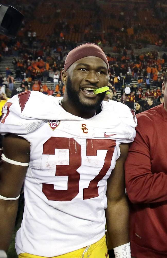 Southern California interim football coach Ed Orgeron, right, celebrates with running back Javorius Allen after winning an NCAA college football game against Oregon State in Corvallis, Ore., Friday, Nov. 1, 2013. Allen rushed for 133 yards and scored three touchdowns as USC won 31-14