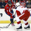 Washington Capitals left wing Alex Ovechkin (8), from Russia, attempts to shoot past Detroit Red Wings defenseman Brendan Smith (2) in the first period of an NHL hockey game, Wednesday, Oct. 29, 2014, in Washington. (AP Photo/Alex Brandon)