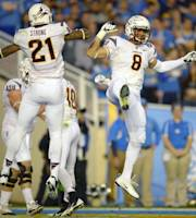 Arizona State running back D.J. Foster, right, celebrates his touchdown with wide receiver Jaelen Strong during the first half an NCAA college football game against UCLA, Saturday, Nov. 23, 2013, in Pasadena, Calif. (AP Photo/Mark J. Terrill)