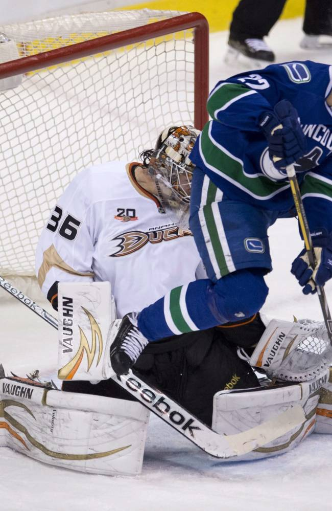 Vancouver Canucks left wing Daniel Sedin (22) jumps as he tries to get a shot past Anaheim Ducks goalie John Gibson (36) during the first period of NHL action in Vancouver, British Columbia, on Monday, April 7, 2014