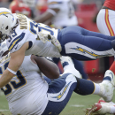 San Diego Chargers running back Danny Woodhead (39) dives for a touchdown over teammate Johnnie Troutman (63) during the second half of an NFL football game against the Kansas City Chiefs in Kansas City, Mo., Sunday, Nov. 24, 2013 The Associated Press