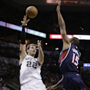 San Antonio Spurs' Tiago Splitter (22), of Brazil, shoots over Atlanta Hawks' Al Horford (15) during the first half of an NBA basketball game, Monday, Dec. 2, 2013, in San Antonio The Associated Press